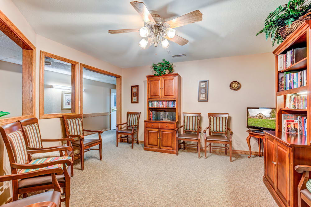 Brightly lit library complete with wood accents at Brookstone Estates of Rantoul in Rantoul, Illinois