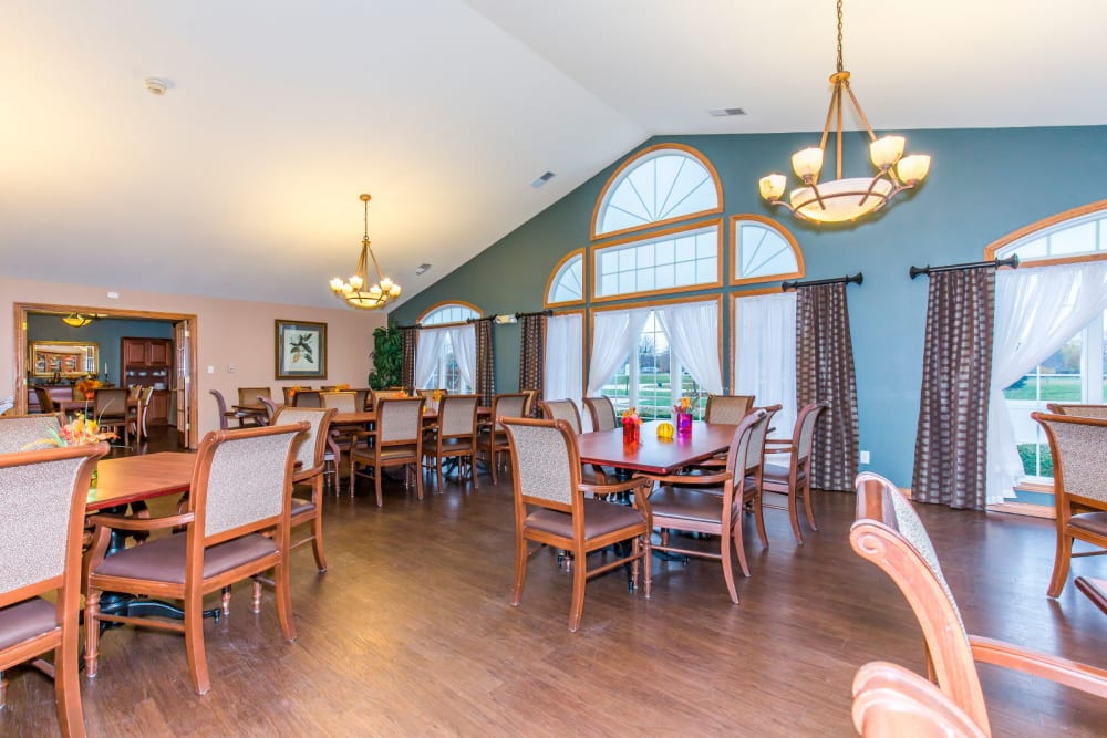 Elegant dining room complete with hardwood floor and chandeliers at Brookstone Estates of Rantoul in Rantoul, Illinois
