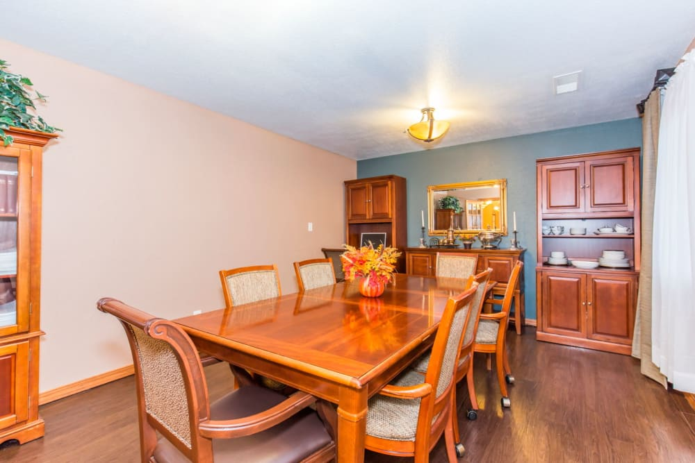 Dining room complete with wood accents at Brookstone Estates of Rantoul in Rantoul, Illinois