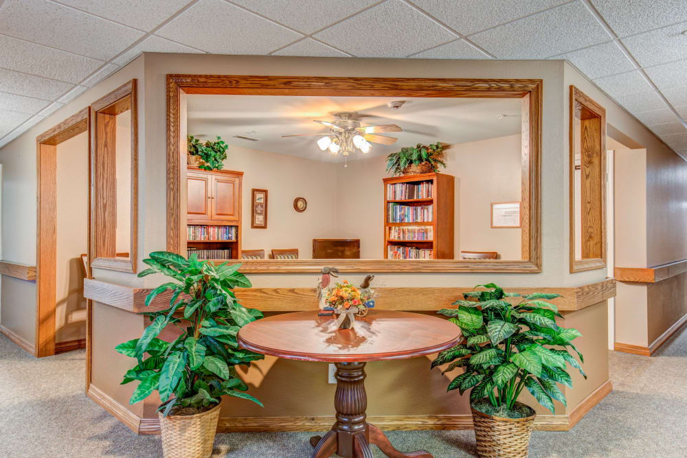 Lobby complete with wood accents and foliage at Brookstone Estates of Rantoul in Rantoul, Illinois