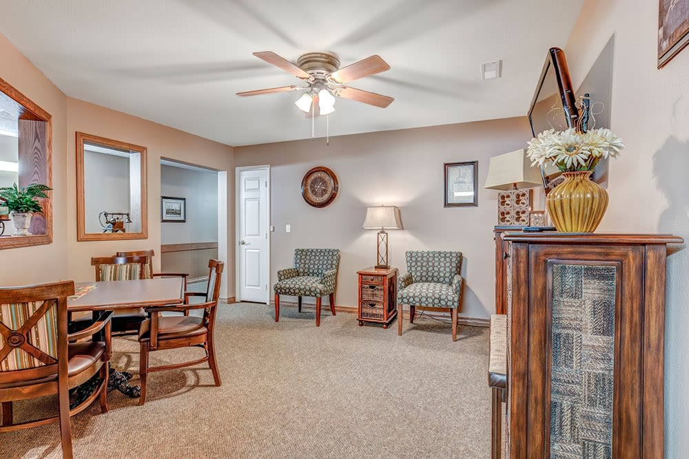 Sitting room with fan and wood accents at Brookstone Estates of Paris in Paris, Illinois