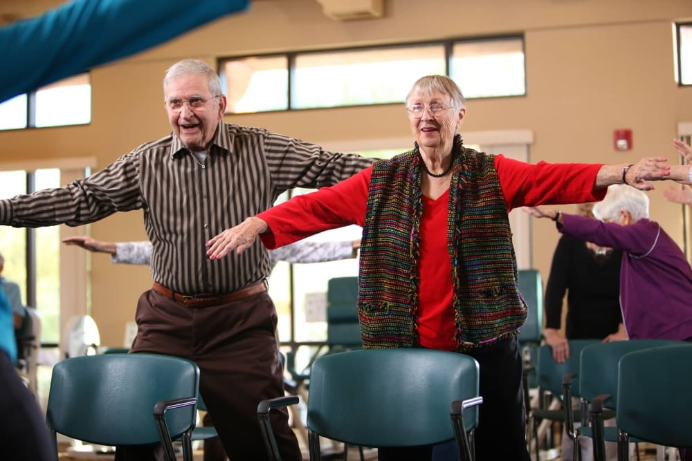 Residents enjoying themselves in an exercise/dance class at Brookstone Estates of Paris in Paris, Illinois