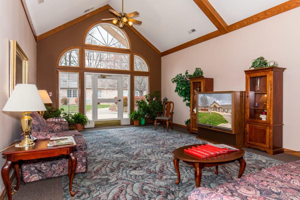 TV room with elegant wood accents and large window at Brookstone Estates of Paris in Paris, Illinois