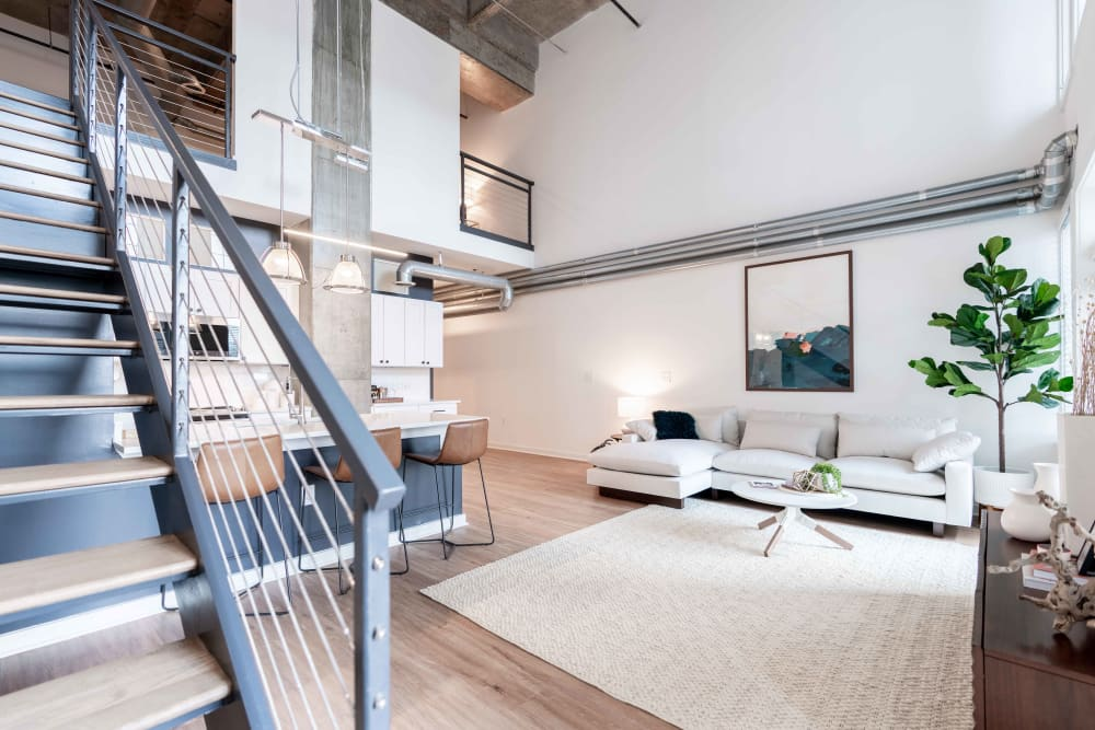 Open living room with modern decor and furniture at 17th Street Lofts in Atlanta, Georgia