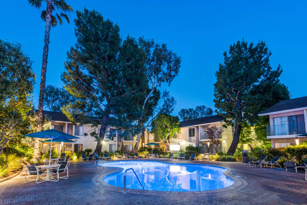 Dusk at the swimming pool with underwater lights on at Village Pointe in Northridge, California