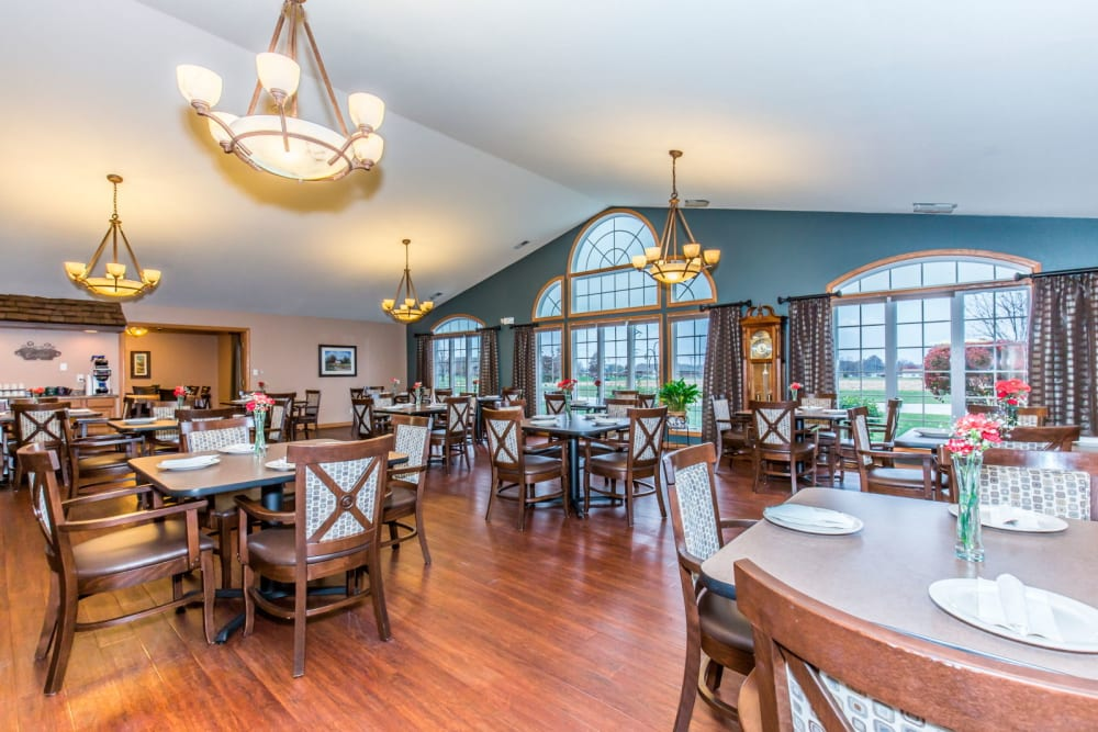 Elegant dining room with chandeliers at Brookstone Estates of Olney in Olney, Illinois