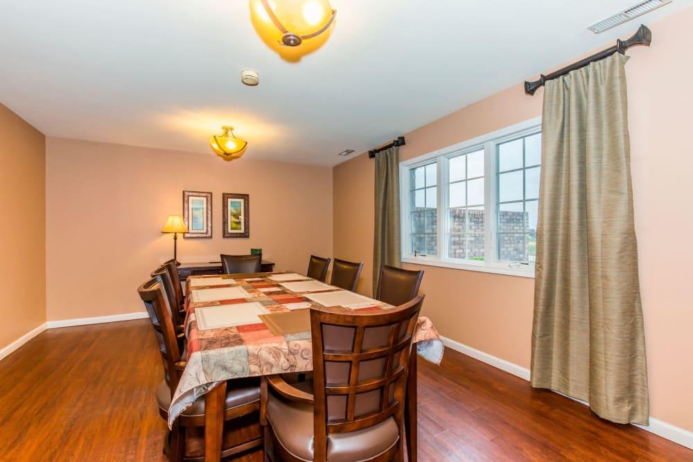 Dining room with hardwood floor at Brookstone Estates of Olney in Olney, Illinois