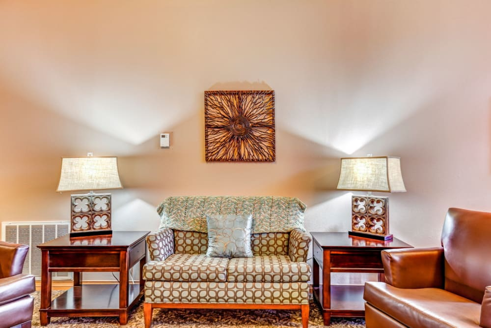 Quaint, well lit sitting room at Brookstone Estates of Olney in Olney, Illinois