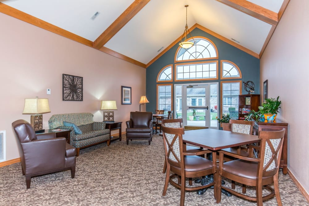 Sitting room complete with wood acents and wood table at Brookstone Estates of Olney in Olney, Illinois