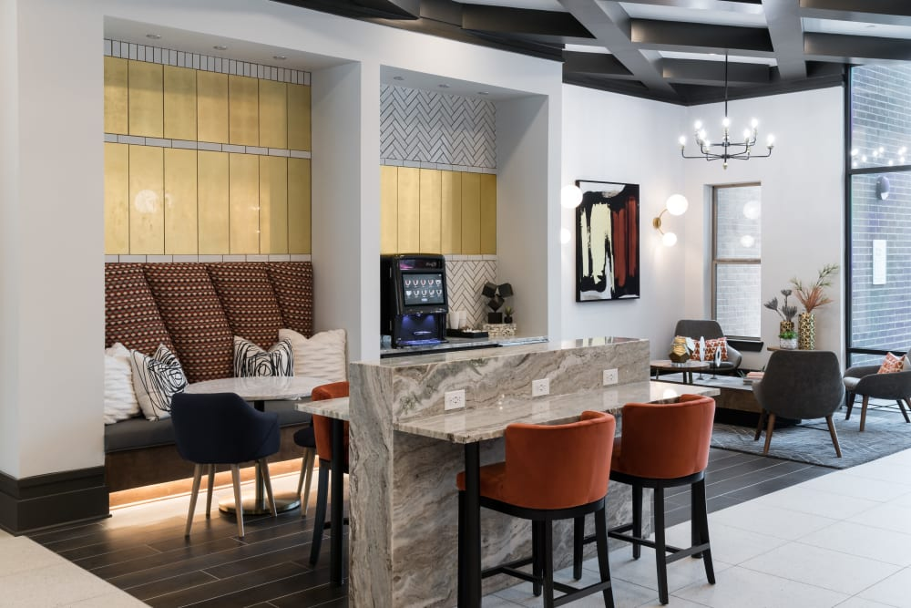Resident lounge area with bar at The ReVe in Garland, Texas