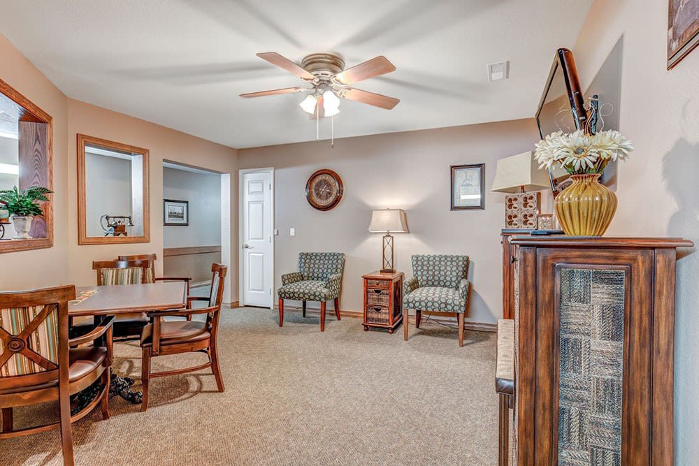 Lounge of upscale senior living facility complete with chairs and tables at Brookstone Estates of Mattoon North in Mattoon, Illinois