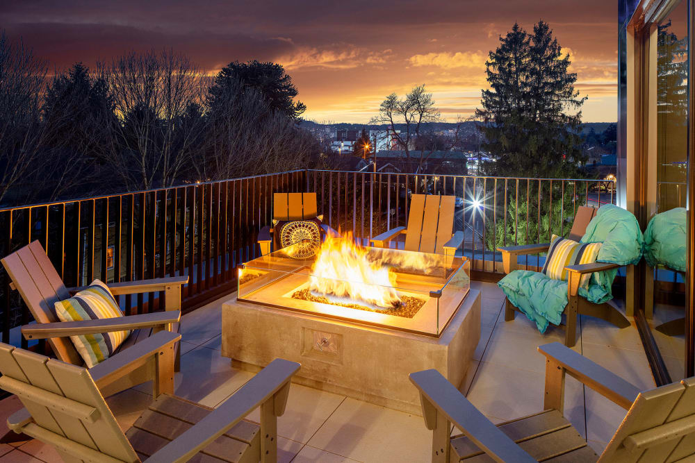 Fire pits on during a sunset outside at Sandy Fifty One in Portland, Oregon