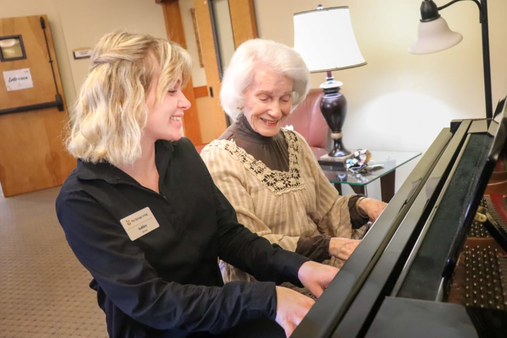 Resident and caregiver playing the piano at The Springs at Mill Creek in The Dalles, Oregon