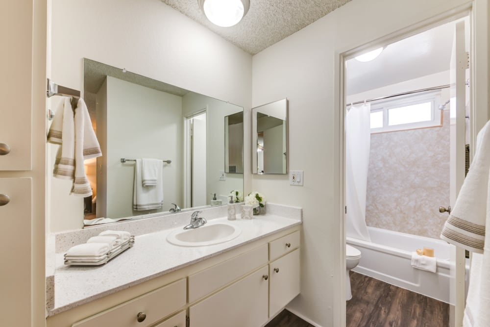 Bathroom with white cabinets at The Enclave in Studio City, California