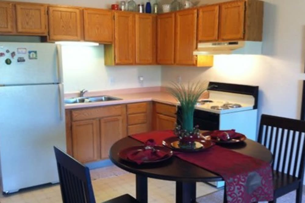 Cozy dining room with wood cabinetry at  Avalon Assisted Living Community in Fitchburg, Wisconsin
