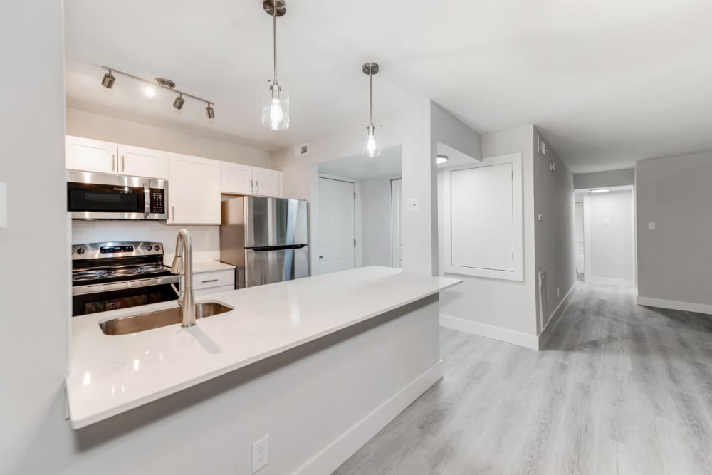 Tons of counter space in the kitchen on nice granite countertops at The Flats at Arrowood in Charlotte, North Carolina