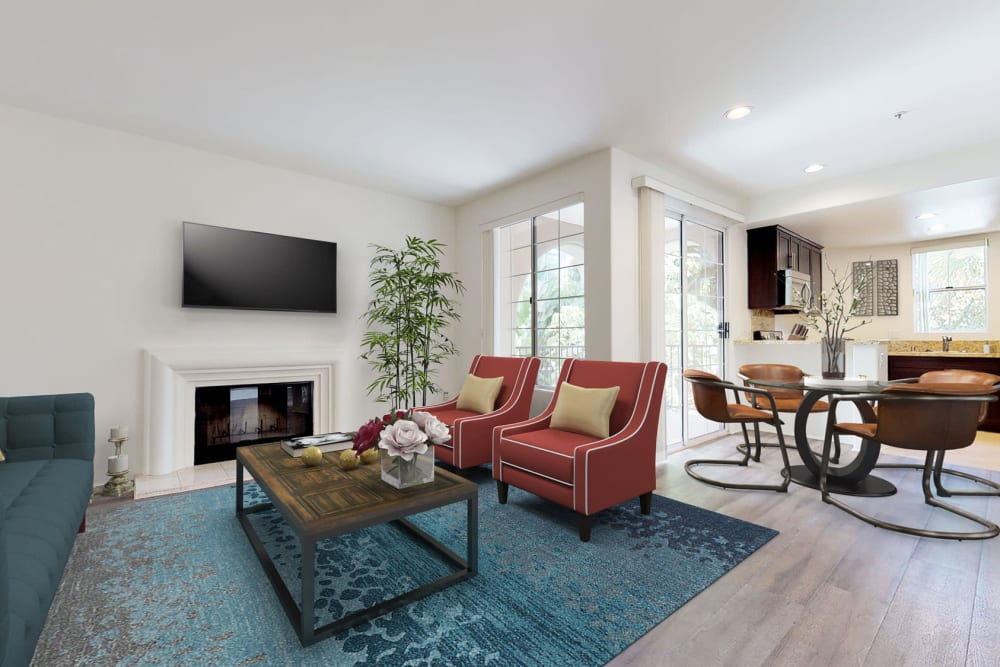 Well-furnished living area in an open-concept model home at L'Estancia in Studio City, California