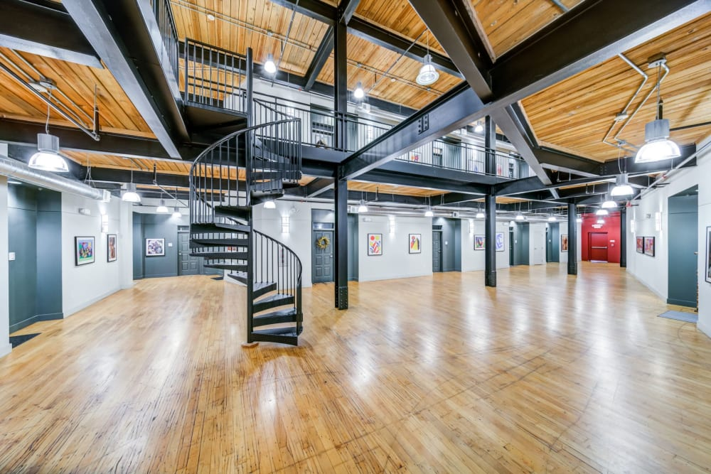 Spacious foyer with a spiral staircase in the middle at The Gallery Lofts in Winston Salem, North Carolina