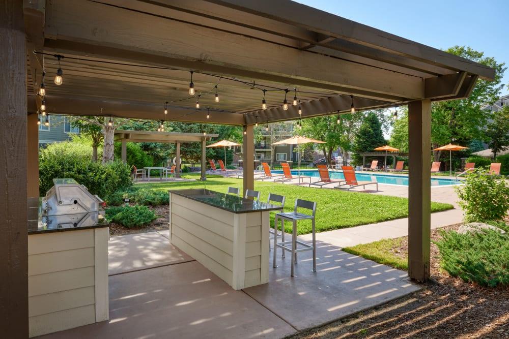 Poolside BBQ Area at Legend Oaks Apartments in Aurora, Colorado