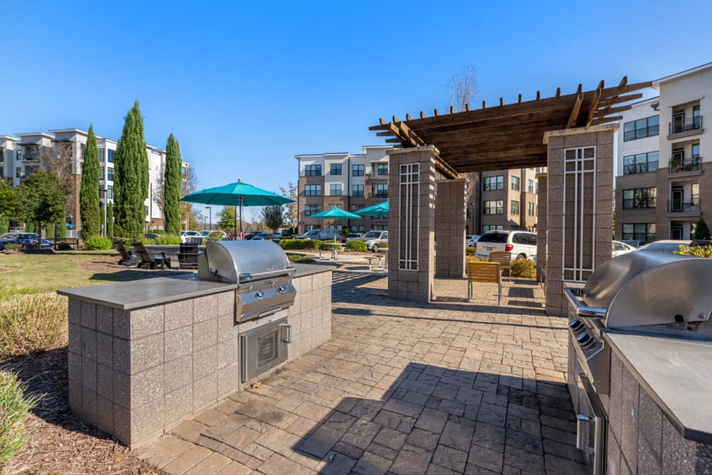 Stainless steel BBQs with nearby gazebo at Marq at Crabtree in Raleigh, North Carolina