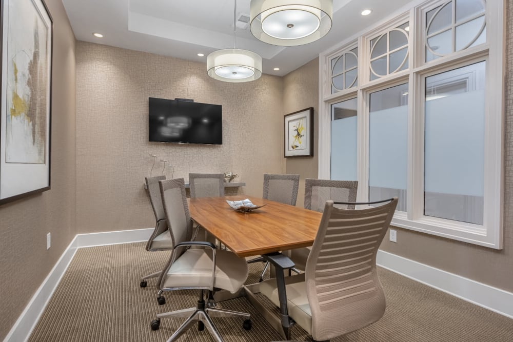 Executive business meeting room with large table and television monitor at Marq at Crabtree in Raleigh, North Carolina