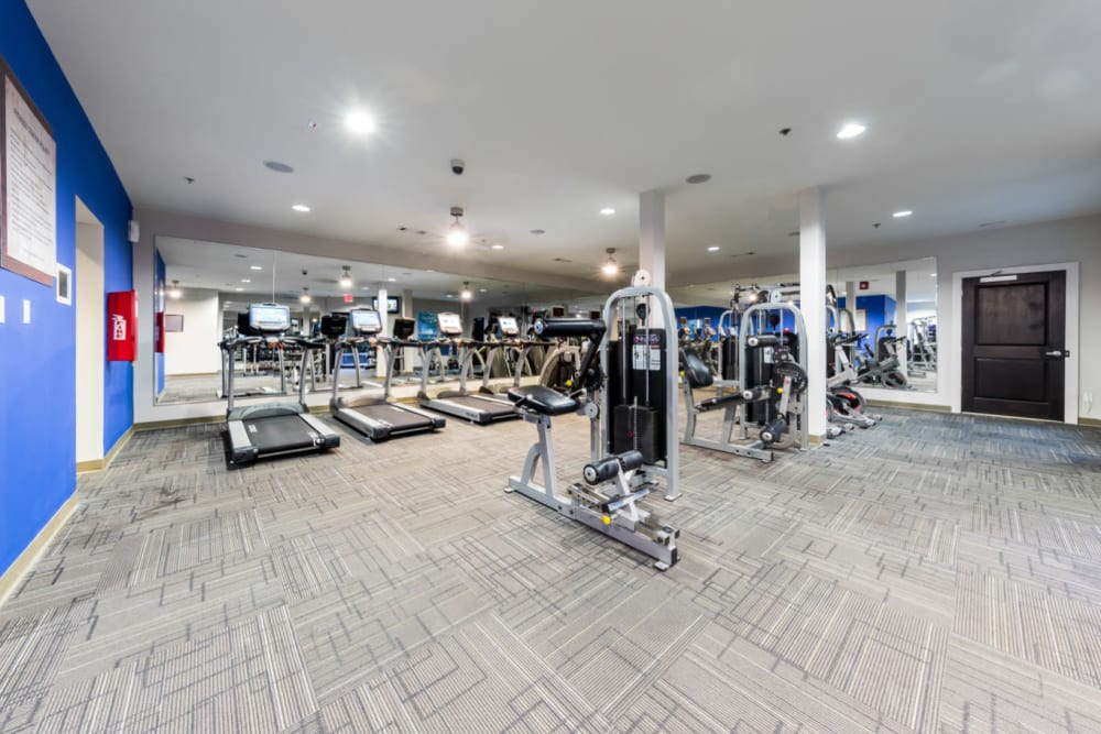 Assisted weight machines with cardio machines in background in fitness room at Marq Eight in Atlanta, Georgia