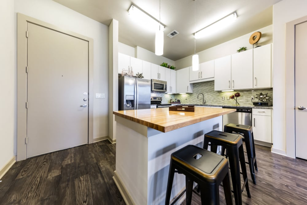 Kitchen with white cabinetry at Marq Uptown in Austin, Texas