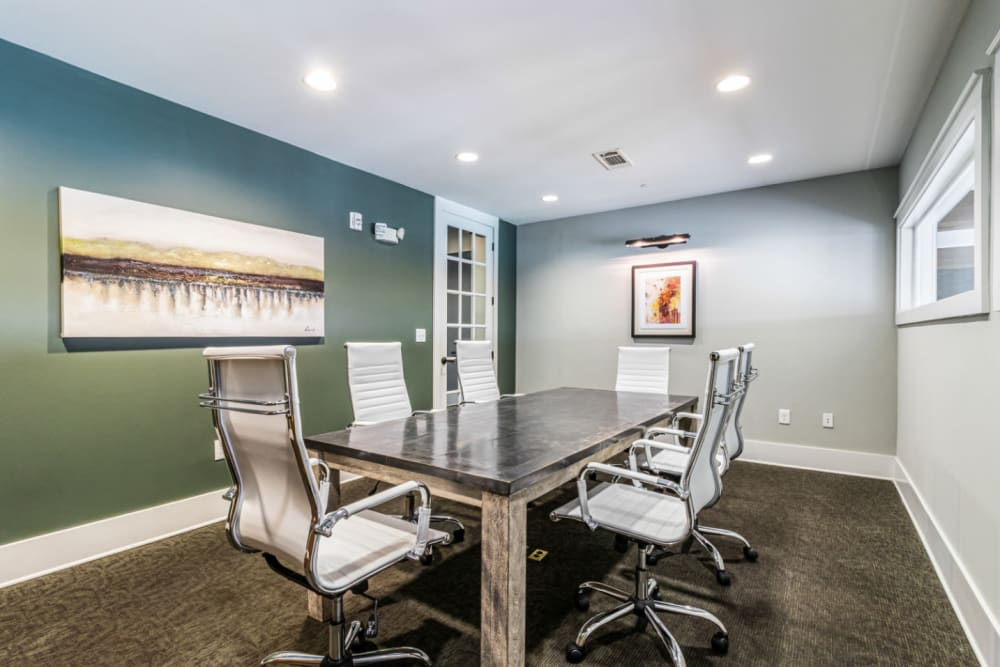 Business meeting room with large table and high back chairs at Marquis at Buckhead in Atlanta, Georgia