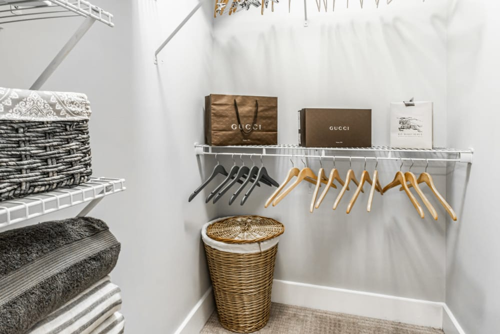 Large walk in closet with built in shelves and clothing organizer at Marquis at Buckhead in Atlanta, Georgia
