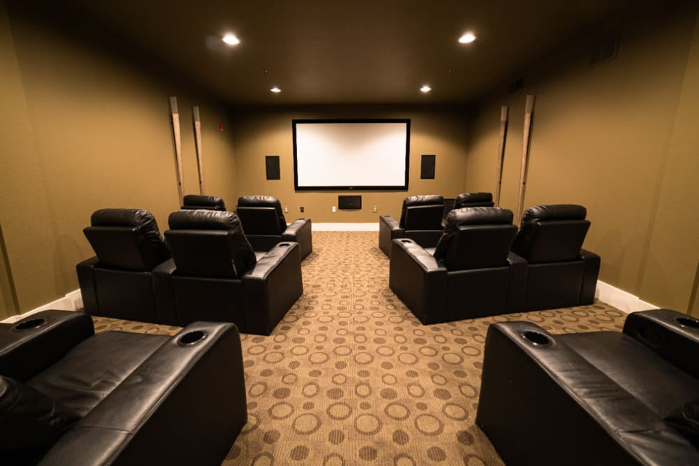 Private community theater with leather seats at Marquis at Texas Street in Dallas, Texas