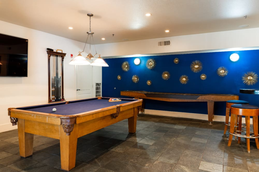 Game room with pool table and shuffle board at Marquis at Texas Street in Dallas, Texas
