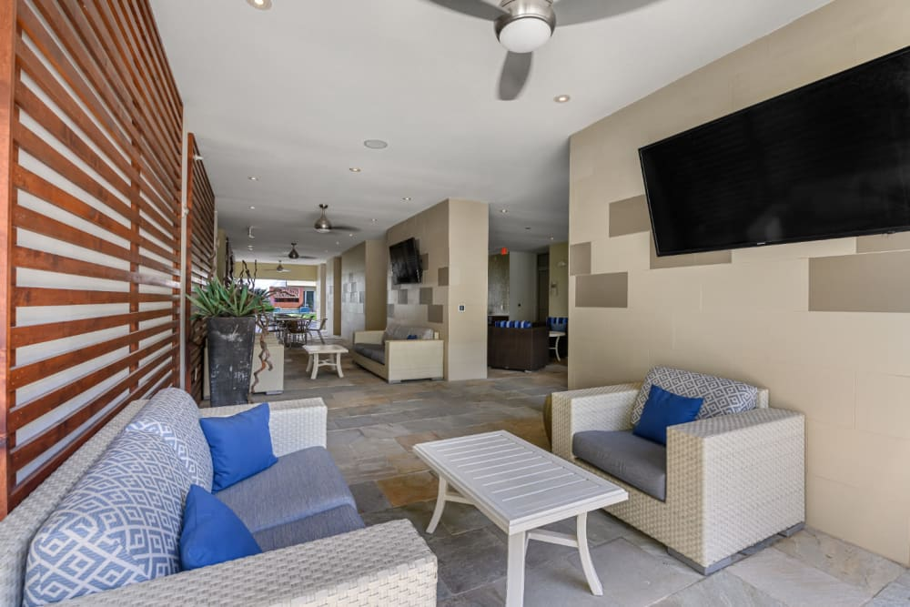Community clubhouse sitting area with large television monitor at Sabina in Austin, Texas
