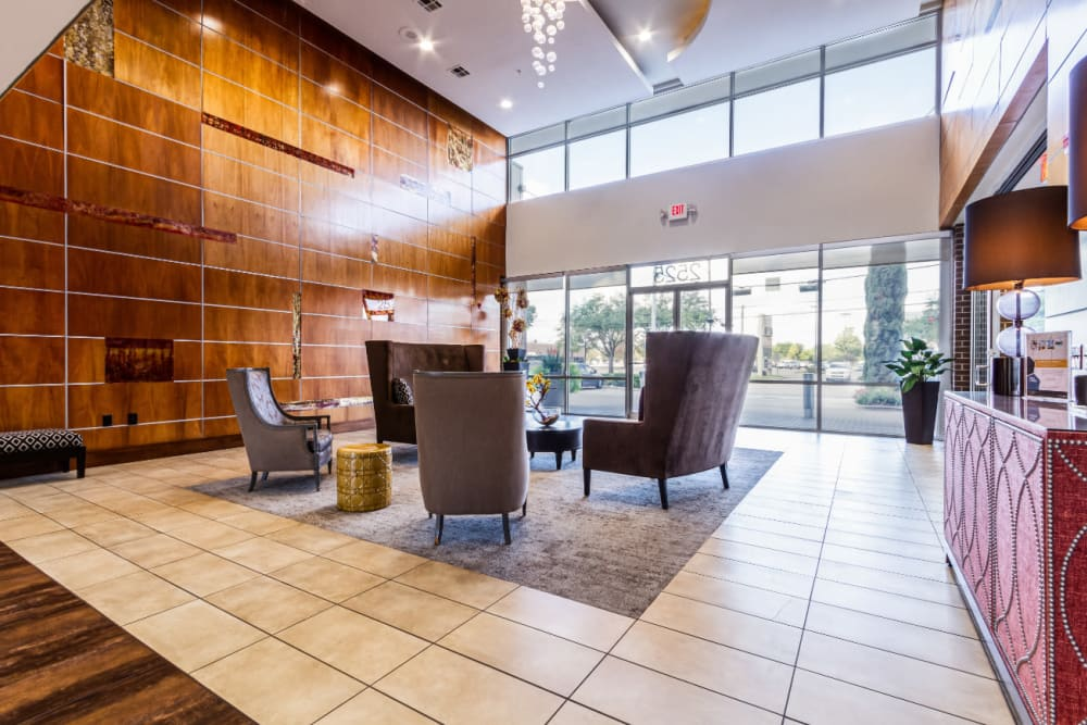 Lobby entrance with couches and seating chairs at The Marq on Voss in Houston, Texas