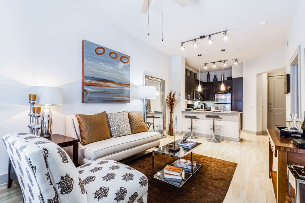 Open living floor plan with modern furniture and décor at The Marq on Voss in Houston, Texas