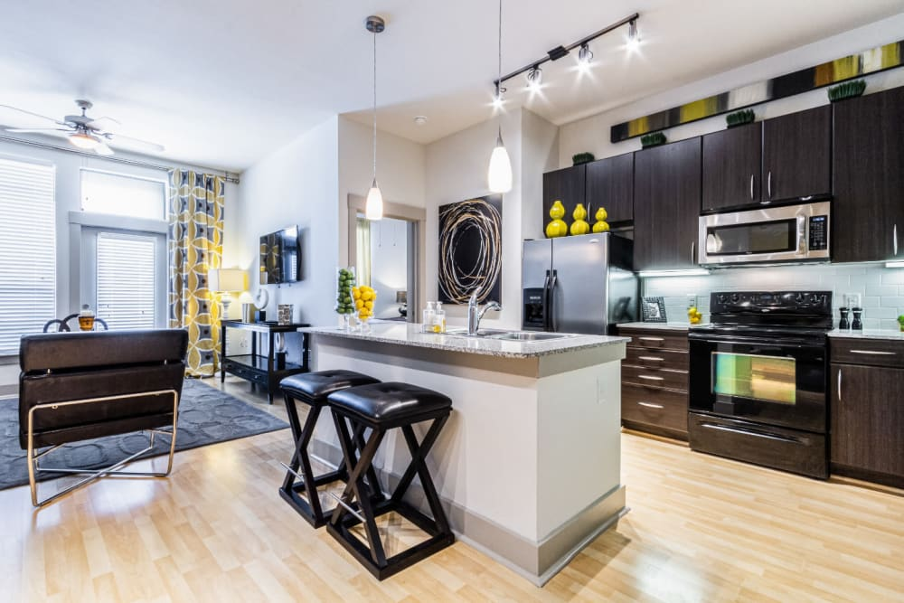 Open and modern floor plan with upgraded appliances and modern furnishings at The Marq on Voss in Houston, Texas