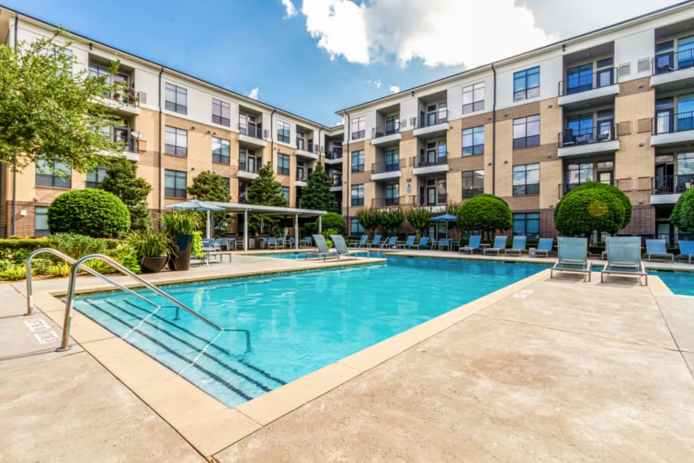 Pool deck with lounge chairs at The Marq on Voss in Houston, Texas
