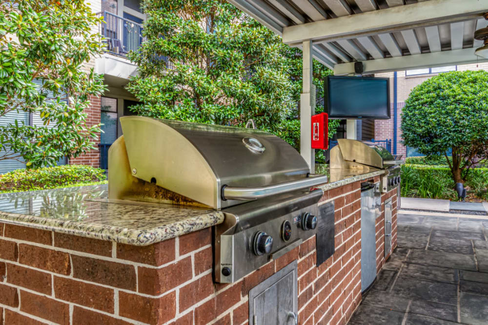 BBQ grills set in brick with granite countertop at The Marq on Voss in Houston, Texas