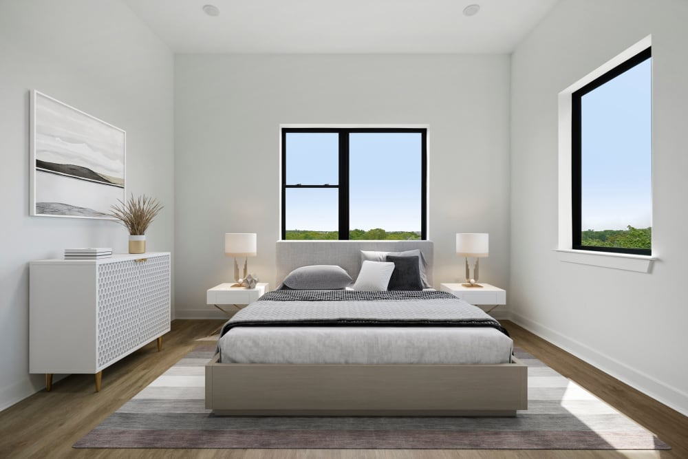 Large bedroom with windows at The Aeronaut in Weymouth, Massachusetts