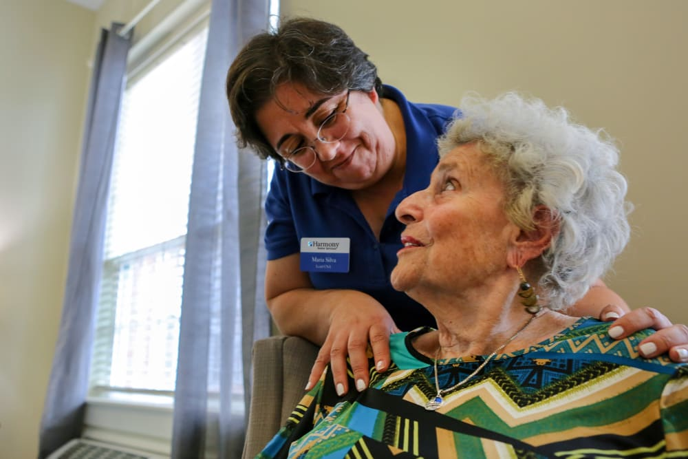 A staff member helping a resident at Harmony at Elkhart in Elkhart, Indiana