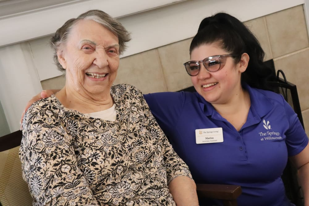 Smiling resident and caregiver at The Springs at Willowcreek in Salem, Oregon