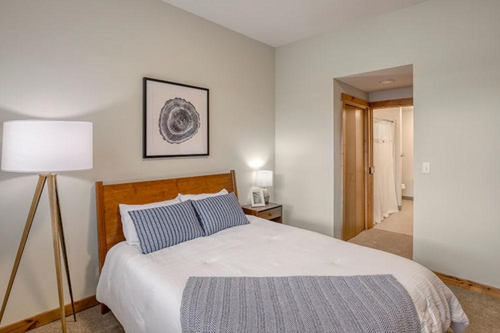 Well lit senior living bedroom at The Springs at Sherwood in Sherwood, Oregon