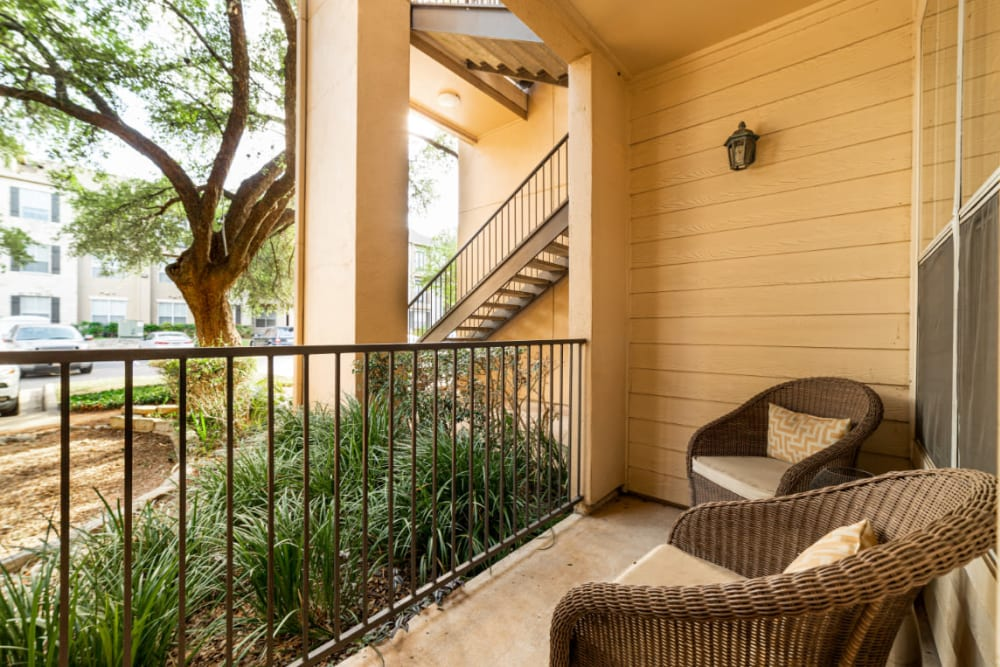 Private balcony with outdoor seating furniture at Marquis at Great Hills in Austin, Texas