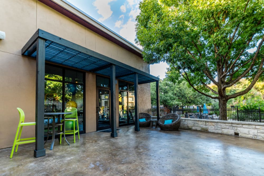 Outdoor seating wicker chairs and tall table and chairs at Marquis at Great Hills in Austin, Texas