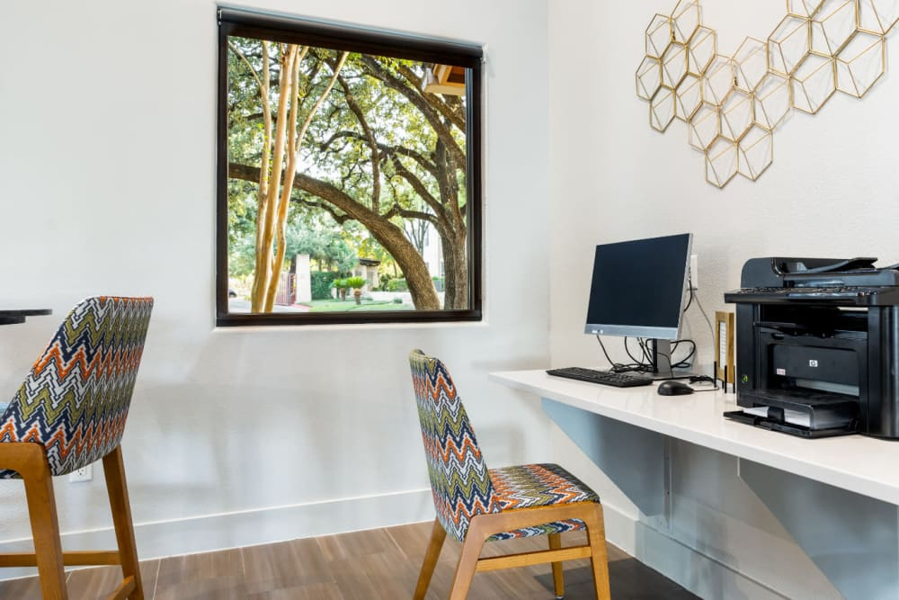 Computer workstation with printer next to window at Marquis at Great Hills in Austin, Texas