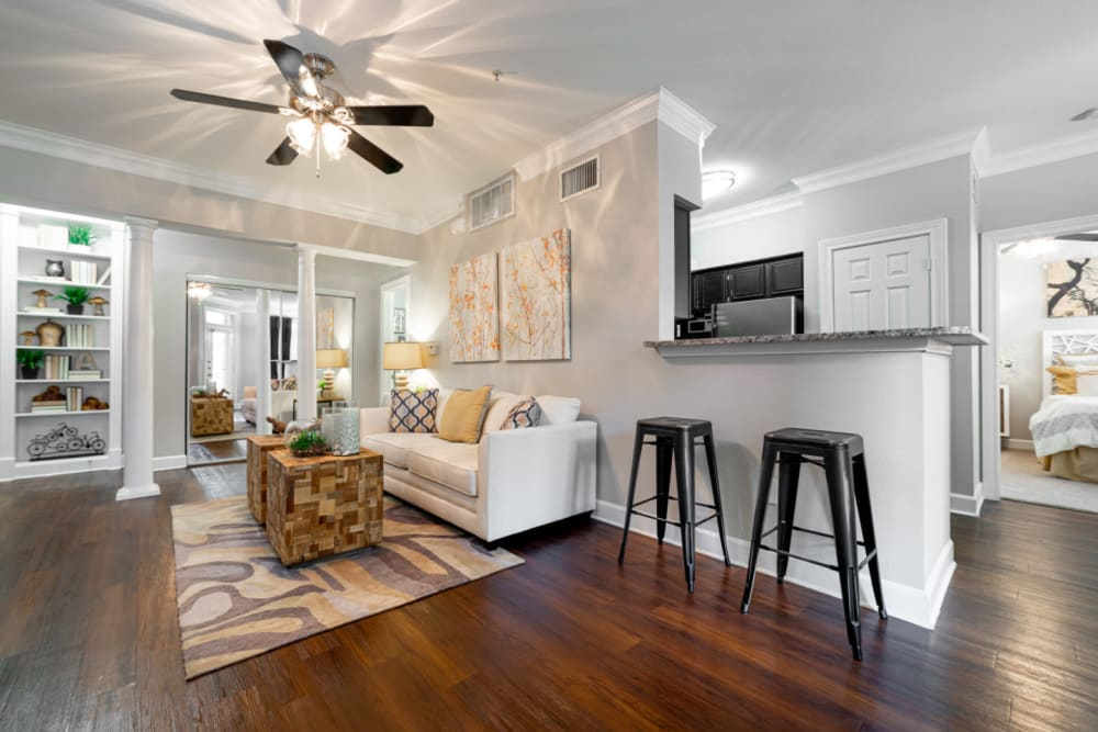 Open living space in living room and kitchen area at Marquis at Great Hills in Austin, Texas