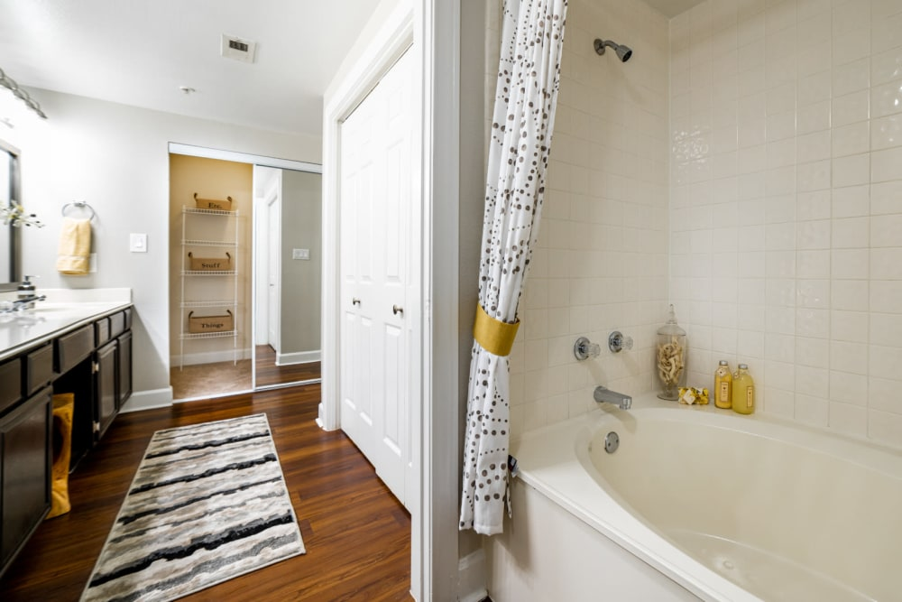 Bathtub and linen closet in bright bathroom at Marquis at Great Hills in Austin, Texas
