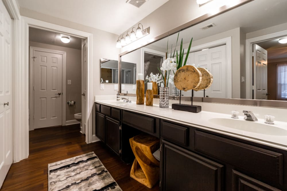 Large bathroom with double sinks with separate shower and toilet area at Marquis at Great Hills in Austin, Texas