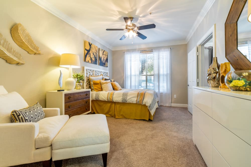 Large, spacious bedroom with sitting area at Marquis at Great Hills in Austin, Texas
