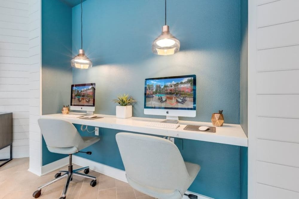 Business center workstations with iMacs at Carvel Harbour Pointe in Mukilteo, Washington