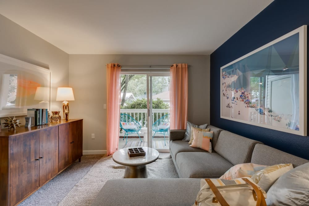 Living room with view of private balcony at Carvel Harbour Pointe in Mukilteo, WA